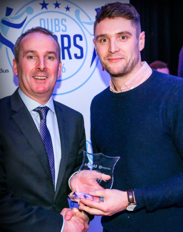 Dublin CEO Ray Coyne presents St Jude's footballer Mark Sweeney with his Dub Stars award. Pic: Colin O'Riordan
