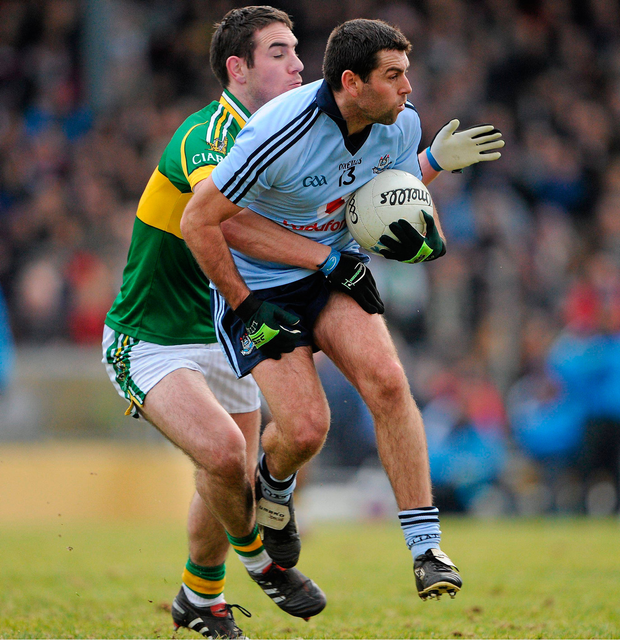 Dublin's David Henry beats Kerry's Declan O'Sullivan to the ball during their Allianz FL 1 clash in February 2010 at Fitzgerald Stadium, Killarney. Pic: Sportsfile
