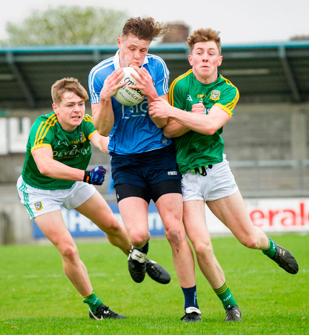 Dublin's Donal Ryan is tackled by Meath's Seán Ryan (left) and Adam Murphy in Saturday's Electric Ireland Leinster MFC first round at Parnell Park. Pic: Doug O'Connor