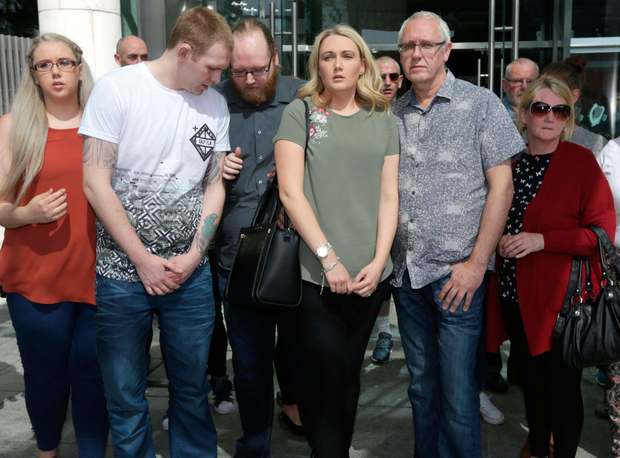 Sonia Blount's sister Claire Reddan (centre) and mother Patricia (right) with friends and family outside court