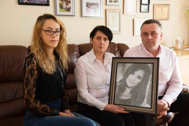 Maggie Gibadlo and her parents Malgorzta and Jozef with a photo of Sara