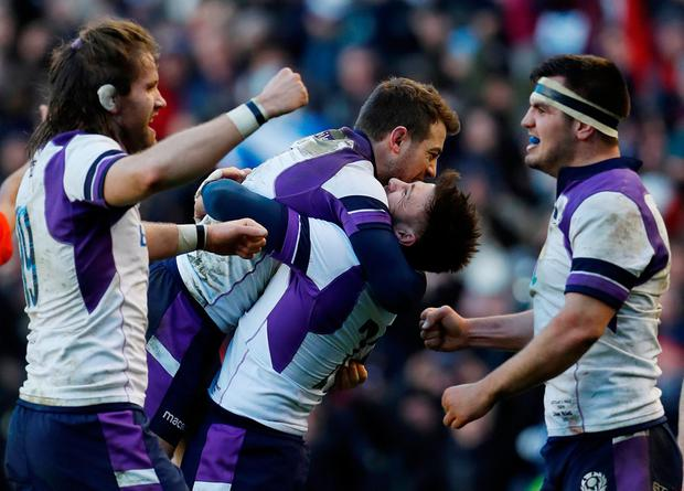 HUGE WIN: Scotland players celebrate the win at the end Photo: Reuters