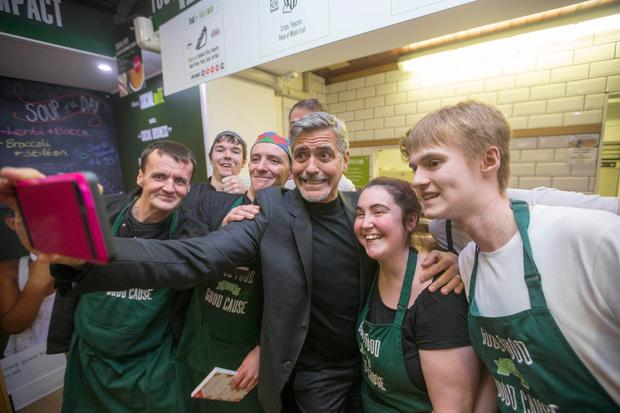 EDINBURGH, SCOTLAND - NOVEMBER 12: (EXCLUSIVE COVERAGE) Actor George Clooney (C) poses with former homeless staff members during a visit to Social Bite sandwich shop on November 12, 2015 in Edinburgh, Scotland. (Photo by Jeff Holmes/Getty Images)