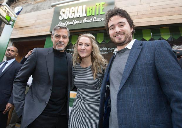 EDINBURGH, SCOTLAND - NOVEMBER 12: (EXCLUSIVE COVERAGE) Actor George Clooney (L) during a visit to Social Bite sandwich shop, where he met owners Alice Thompson, (C) Josh Littlejohn (R) and former homeless staff members on November 12, 2015 in Edinburgh, Scotland. (Photo by Jeff Holmes/Getty Images)