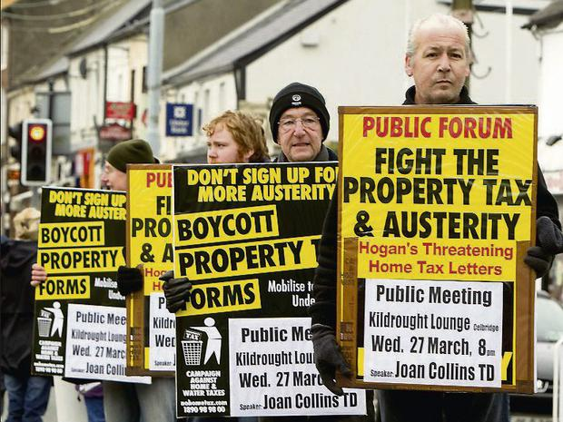 David Coss from the Willowbrook estate in Celbridge pictured on the main street of the town with fellow protestors against the property tax. Photo: Gerry Mooney