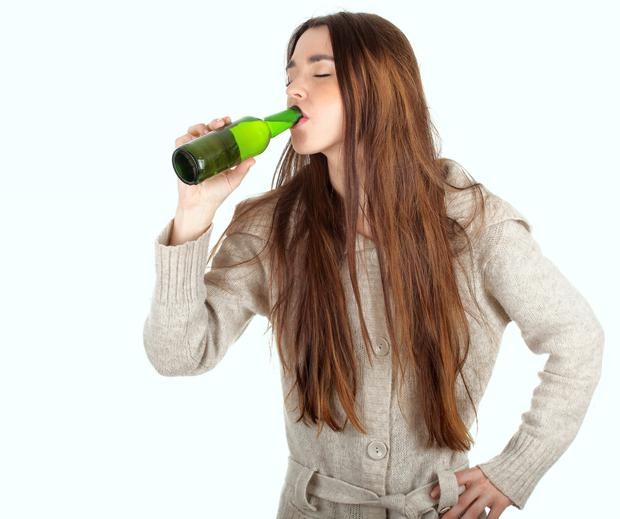 Drinking a single glass of wine or beer at 14 can put teens at risk of binge drinking, say scientists (picture posed)