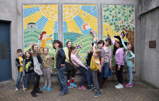 Principal Ann Creaner (left) with the children of St Columba's School, North Strand and artist Fionnuala Halpin who designed and made a mural on display at Croke Park. Photo: Tony Gavin