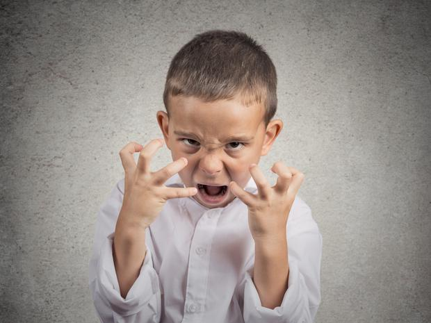 Angry child. Picture posed.
