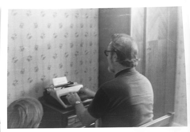 Dave as a small boy looking at 'the dad who raised him' work away on a typewriter