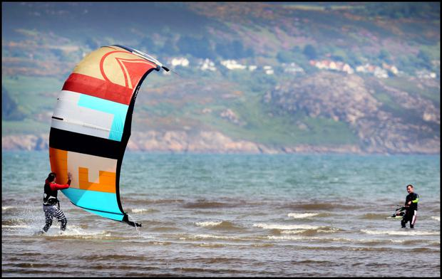 Kite surfing at Dollymount Strand yesterday during the hot weather. Pic Steve Humphreys