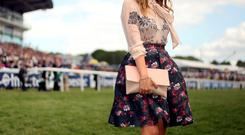 Laura Whitmore poses for photographers on Derby Day of the 2015 Investec Derby Festival at Epsom Racecourse, Epsom. Photo: Steve Parsons/PA Wire