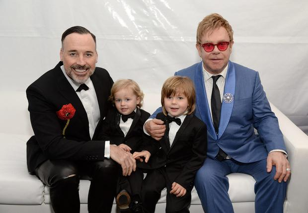 Elton John pictured with his family