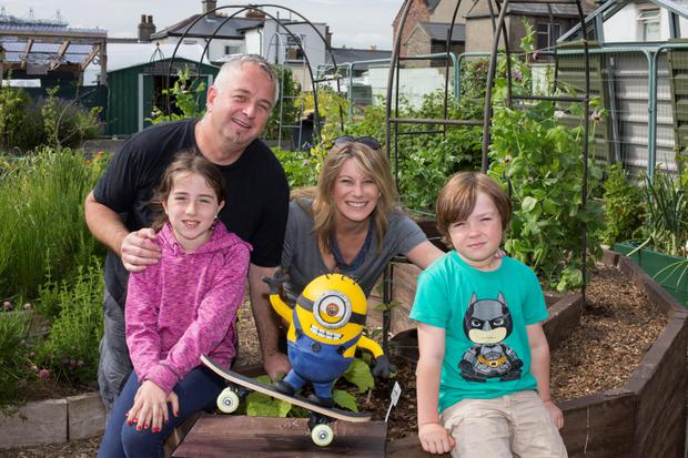 Paul Redmond with his children Amber (8) and Cody (6) and writer Carol Hunt