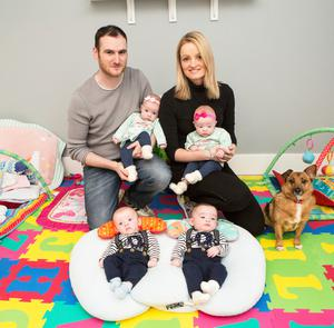 Limerick quadruplets Alexander Matthew, Ashley Cienna, Maxwell Lucas, and Kayla Marie with their mum and dad.