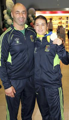 Katie Taylor with her dad, and trainer, Pete pictured at Dublin Airport after arriving home after winning her fifth World Title in Korea