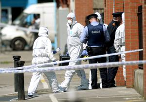 Gardai and forensics officers at the scene of Gareth Hutch's murder