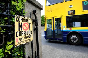 One of the messages pinned to gates by residents objecting to the transport corridor project. Photo: Frank McGrath