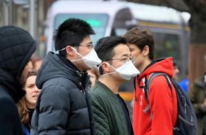 Members of the public wearing surgical masks on O'Connell Street