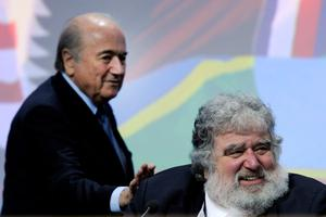 A file photo taken on June 1, 2011 shows FIFA President Sepp Blatter (L) tapping the shoulder of the general-secretary of the Caribbean, North and Central American (CONCACAF) Chuck Blazer