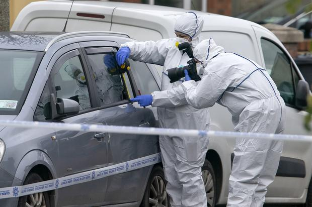 Gardai examine a car with a bullet hole in a window in Bettystown