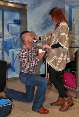 Martin Mulroe proposes to Louise Mooney in Dublin Airport. Photo: Colin Keegan