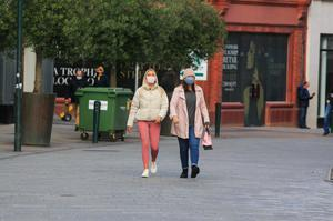 Shoppers wear masks while strolling in Grafton Street yesterday