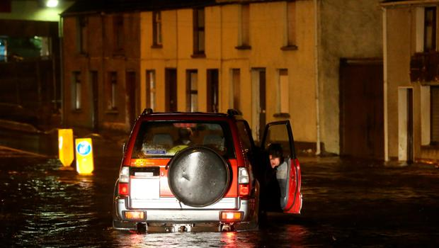A motorist gets stuck in a flood in the Castlefin area of Donegal