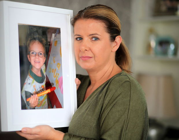 Maria Coyne with a photo of her son Gavin