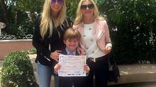 Robbie and Claudine Keane's son Robert Jnr looked every inch the model student as he graduated from kindegarten (pictured with mum Claudine and her mother Joan Palmer)