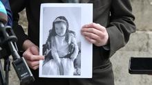 Declan Kilgallon with photo of daughter Robyn outside court