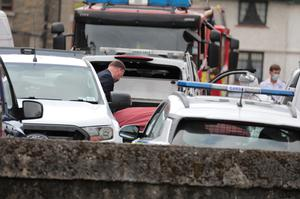 The body is removed from the scene at a house in St Michael's Road, Drumcondra. Photo: Paddy Cummins / Collins Photos