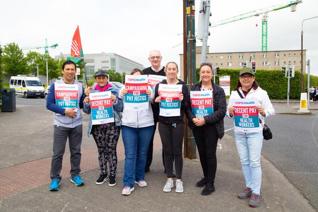 Staff take to the streets at St Vincent's. Photo: Sunday World