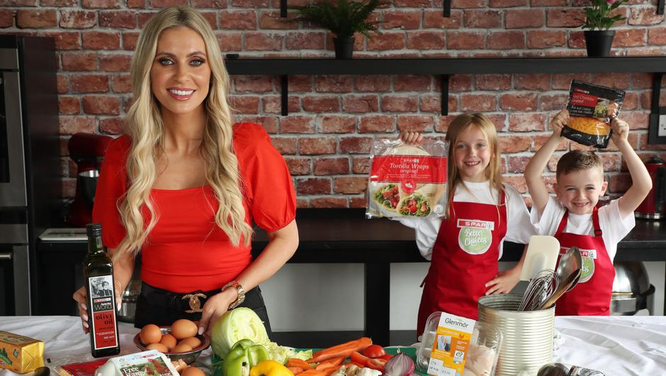 Lucy (10) and Hugh Horgan (7) with Claudine Keane to launch SPAR's Better Choices Back to School campaign
