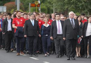 Mourners walk to the Church of the Three Patrons, Rathgar for the funeral mass of Niccolai Schuster.