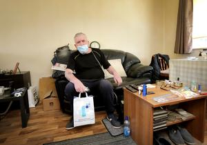 Donal Byrne in his flat at Sandyhill Gardens in Ballymun after Pat made his delivery from McManus Pharmacy