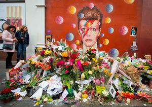 Floral tributes in Brixton, south London (PA)