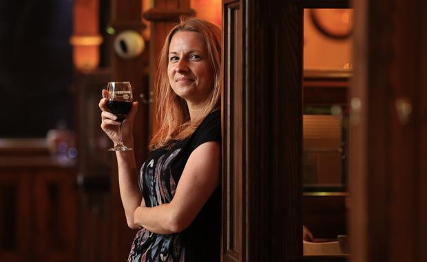 Irena Gronowska looks out from the new partitions in O'Gormans pub, Portlaoise. Photo: Gerry Mooney