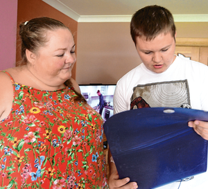 Hardworking mother Carol Lennon with her son Tristan, who has been offered a place at UCD