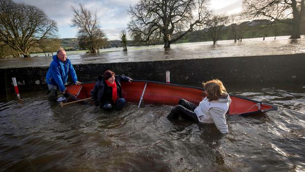Tanaiste Joan Burton and Rural Minister Ann Phelan got a taste of what life is like for flood victims when the canoe they were in overturned. Photo: Dylan Vaughan Photography