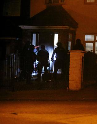 An Armed Support Unit breach the door of the Finglas house