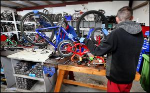 Prisoners at Loughan House working on the bikes