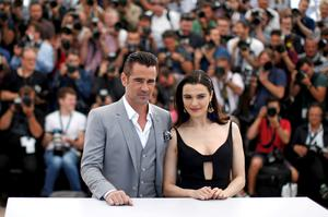 """Cast members Rachel Weisz and Colin Farrell pose during a photocall for the film """"The Lobster"""