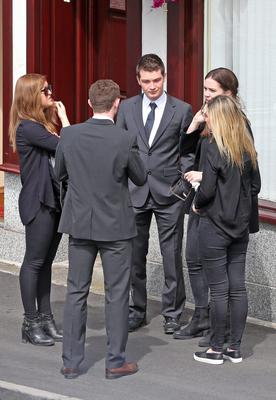 Friends console each other outside Fanagan's Funeral Home, Dundrum this afternoon where the remains of Berkeley balcony collapse victim, Eimear Walsh are reposing prior to her funeral mass which will take place at in the Church of Our Lady of Perpetual Succour in Foxrock in Dublin