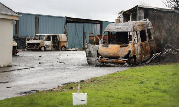 Burnt-out vehicles at the farm in Strokestown after a mob stormed it