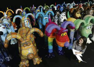 SALE: Dani Marlborough from Gromit Unleashed among some of the giant Gromit sculptures which were auctioned for charity