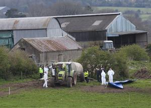 Gardai at the Fawnagowan farm, where the body of Bobby Ryan was found in 2013
