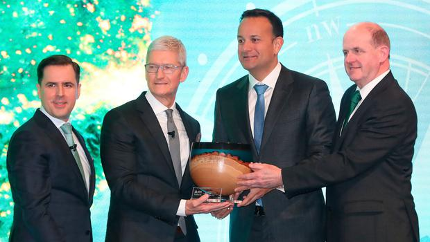 Leo Varadkar joins Martin Shanahan and Frank Ryan of the IDA to present Apple's Tim Cook with an award at the National Concert Hall in Dublin