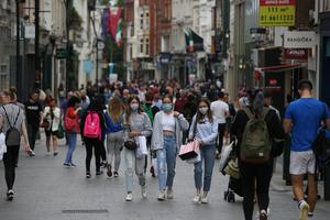 Young people wearing masks on Grafton Street in Dublin city centre as fears grow about huge surge of cases in the capital. Photo: Stephen Collins / Photos