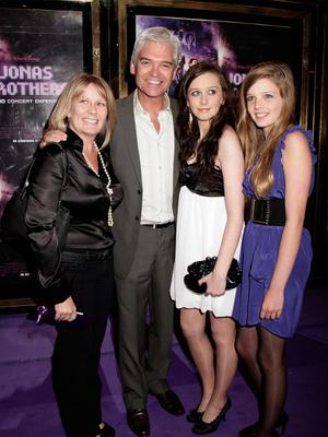 Phillip Schofield with his wife Steph and their two daughters Molly and Ruby. Photo: PA