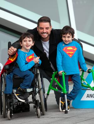 Keith Duffy with former conjoined twins Hassan and Hussein Benhaffaf who both receive services from the Irish Wheelchair Association on a weekly basis at the launch of Irish Wheelchair Association's  annual 'Angels' fundraising campaign at The Bord Gais Theatre,Dublin